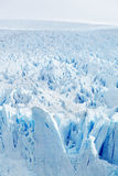 Icy Surface of a Glacier. Winter landscape of a blue, icy frozen glacier Royalty Free Stock Images