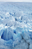 Icy Surface of a Glacier. Winter landscape of a blue, icy frozen glacier royalty free stock image