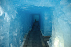 Icy tunnel. Tunnel in glacier somewhere in Switzerland Royalty Free Stock Photography