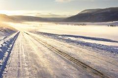 icy väg Arkivfoto