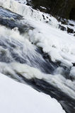 Icy Waterfall. Waterfall in winter, partially covered with snow and ice Stock Photo