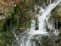 Icy waterfall. Scenic view of rocky waterfall in winter with icicles Royalty Free Stock Photo