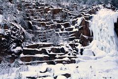 Icy waterfall. Artificial ice waterfall for rock climbing Royalty Free Stock Images