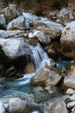 Icy Waters - Glacial River in. Mini falls over some large boulders along a river in the Himalayas, Nepal.  The water comes from melting glaciers higher up the Stock Images