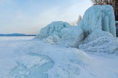 Icy waves on beach of Lake Baikal near Turtle Rock. Stock Photography