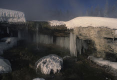 Icy Winter Scene. Ice and snow form on rocks creating a frigid scene Stock Photo