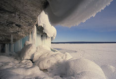 Icy Winter Scene. Ice and snow form on rocks creating a frigid scene Royalty Free Stock Images