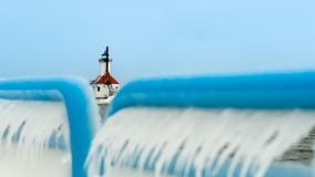 St. Joeseph Michigan North Pier Light House Covered in Ice. This is an icy winter scene from the south pier in St. Joseph Michigan looking at the main stock image