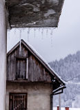 Icycles on a cold winter day eith barn in behind Royalty Free Stock Photography