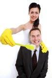 Idée d'émancipation. Dents de brossage de femme de son homme, humeur Photographie stock libre de droits