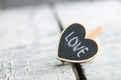 Idée d'amour Carte de voeux de jour du ` s de St Valentine avec le coeur, photo brouillée pour le fond Image stock