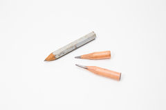 Idée symbolique de crayon de plan rapproché court d'image Image stock