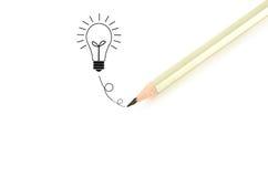 Idéia do bulbo do writingฺ do lápis Fotografia de Stock Royalty Free
