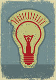 Idélampa. Grunge symbol av den ljusa kulan Arkivfoton