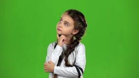 Idén kommer till behandla som ett barnhuvudet grön skärm långsam rörelse lager videofilmer