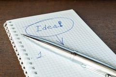 Idén undertecknar in anteckningsboken Arkivbilder