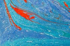 Idérik bakgrund för abstrakt konst i blått tonar med röda linjer och fläckar Arkivfoton