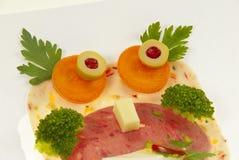 idérik mat för barncloseup Arkivbilder