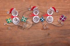 Idérik pappers- julkort på en träbakgrund quilling Arkivfoton