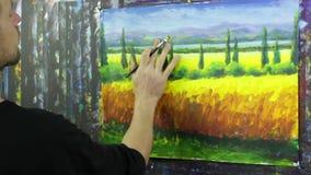 Idérik process för konst Konstnären skapar målning på kanfas arkivfilmer