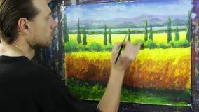 Idérik process för konst Konstnären skapar målning på kanfas stock video