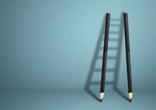 Idérikt begrepp för framgång, blyertspennastege med kopieringsutrymme arkivbilder