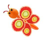 Idérikt matbegrepp Rolig liten fjäril som göras av frukter och Royaltyfri Fotografi