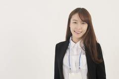 有id卡片的亚裔女实业家 免版税库存照片