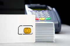 Id card with pos terminal. Closeup of a blank id card with pos terminal in the background Royalty Free Stock Photos