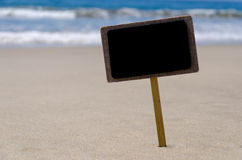 ID-Märke på den sandiga stranden Fotografering för Bildbyråer
