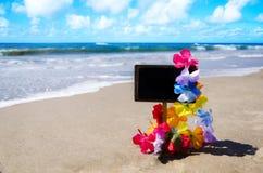 ID-Märke på den sandiga stranden Royaltyfria Bilder