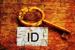 Id tag and old key Royalty Free Stock Images
