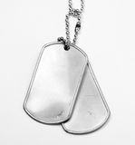 ID tags. Close-up of some military identity tags Royalty Free Stock Photography