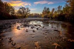 Idaho Boise River with fall leaves at sunrise. Sunrise and fall leaves on the Boise River near Eagle Idaho royalty free stock photo