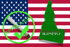 Idaho on cannabis background. Drug policy. Legalization of marijuana on USA flag, Royalty Free Stock Image
