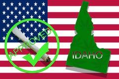 Idaho on cannabis background. Drug policy. Legalization of marijuana on USA flag, Royalty Free Stock Image
