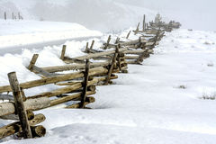 Idaho country road in winter with pole fence Stock Photo