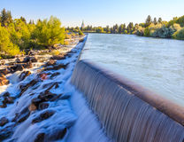 Idaho Falls Power HydroElectric project. Idaho Falls, Idaho - JULY 1, 2012: The small waterfall on Snake River is a part of Power HydroElectric project in Idaho stock photos