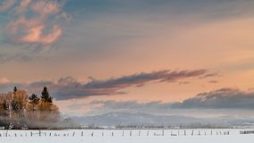 Farm near McCall fields covered with snow fogy sunrise royalty free stock photo