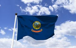 Idaho flag mockup in the wind. The symbol of Idaho. The flag of Idaho as a symbol. Flag of the state of Idaho. Flag of the USA state royalty free illustration
