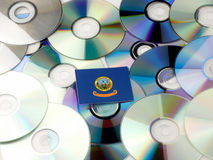 Idaho flag on top of CD and DVD pile isolated on white Stock Image