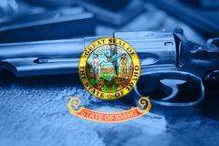 Idaho flag U.S. state Gun Control USA. United States Gun Laws.  Stock Photos
