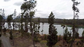 Idaho forest and lake campground with road stock video