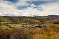 Idaho high mountains desert landscape. Idaho early spring landscape. Mt.Soldier over desert and fields stock image