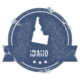 Idaho mark. Travel rubber stamp with the name and map of Idaho, vector illustration. Can be used as insignia, logotype, label, sticker or badge of USA state vector illustration