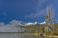 Idaho mountain lake in the fall with misty fog Royalty Free Stock Image
