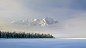 Idaho mountain lake with snow and fog in winter Royalty Free Stock Photos