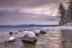 Idaho mountain lake in the winter with rocks and snow Royalty Free Stock Photography