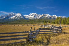 Idaho mountain range and log fence with snow Royalty Free Stock Images