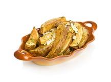 Idaho potato wedges. With dill and garlic Royalty Free Stock Photos